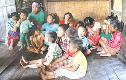 Kids rendered homeless by Assam Rifles take shelter in an old dilapidated hut in Old Somtal Village (The Sangai Express; Sep 1, 2014